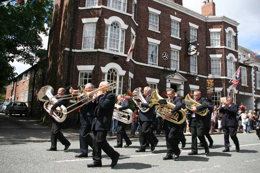 A brass band passes the Swan Hotel, Tarporley